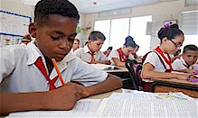 Cuban school children studying inside the revolutionary Caribbean-island nation. The UNESCO agency has recognized the high level of writing among the students. by Pan-African News Wire File Photos
