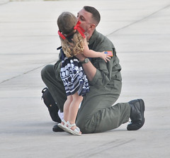 Sailor kisses his daughter after returning home from deployment (Official U.S. Navy Imagery) Tags: family people navy homecoming sailor usnavy guam chldren yigo hsc25 det6 helicopterseacombatsquadron25