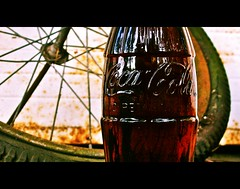 Coca-Cola nostalgia () Tags: summer urban usa sun macro glass sunshine bicycle wheel cane america mexico real photography bottle rust close view image symbol drink no united spokes beverage picture culture rusty coke pop retro sugar nostalgia photograph cult nostalgic americana summertime soda cocacola states refreshing symbolic following imported hfcs