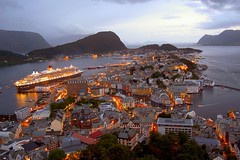 Alesund: A Beautiful Sea Port in Norway (S.A.L.) Tags: voyage bridge cruise sunset italy cold ice beautiful norway port sunrise buildings island dawn lights islands evening boat town italia tramonto mare alba north norwegian nave porto journey romantic nordic northern crociera norvegia sera norse alesund norseman avezzano norvegese nordico
