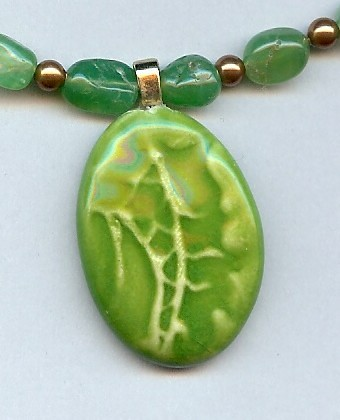 Green fish tail clay pendant