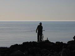 ... (RoBeRtO!!!) Tags: sea sky people cliff man water beautiful fisherman rocks mare gente uomo cielo sicily palermo acqua pescatore scogli marenostrum isoladellefemmine rdpic mywinners canong7