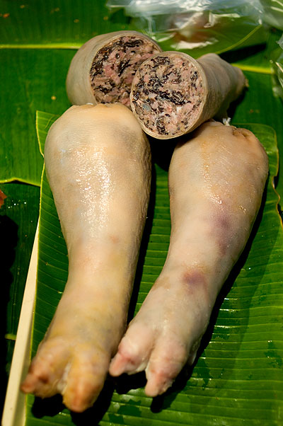 Vietnamese stuffed pig legs, at Mukdahan's evening market.