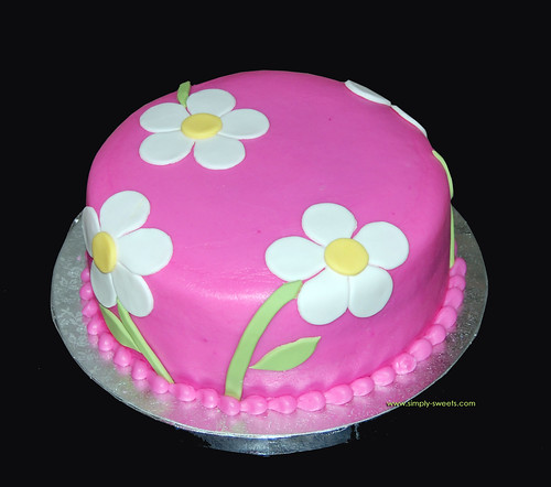 pink with white flowers birthday cake