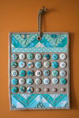 Nie Auction Calendar (rashida coleman-hale) Tags: aqua quilt calendar handmade linen auction buttons covered nie recovery nienie