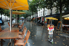 So fall is coming (-Kj.) Tags: street paris wet leaves table restaurant kid chairs parasol 17me trottinette