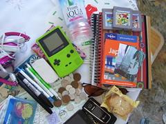 The Things I Carry Japan Edition (chibishimigami) Tags: water sunglasses japan train japanese ipod pass cellphone rail pens passport gameboy yoshi yen notebooks skullcandy