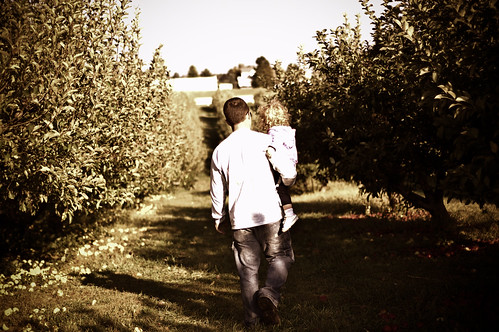 Dad and Lilli in the orchard