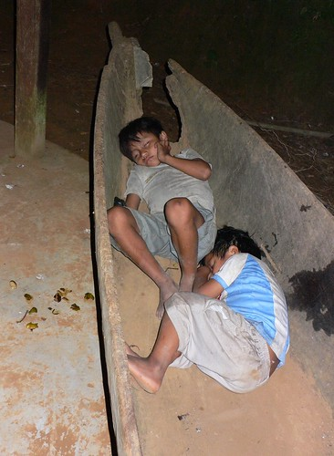 Children sleeping in a canoe in Sarayaku