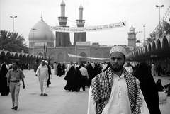 Pilgrims in Karbala (Samer M) Tags: portrait bw man nikon shrine islam iraq middleeast mosque arabic arab arabia karbala iraqi pilgrim imamhussein pilgrimate