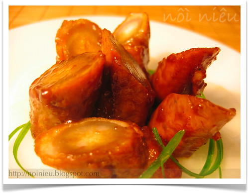 Gobo (Burdock root) wrapped with pork in teriyaki sauce