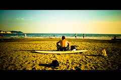 Horizontals: The resting surfer (manganite) Tags: blue sea summer sky people hot men green beach topf25 water colors sport yellow japan strand digital geotagged asian japanese xpro sand topf50 nikon colorful asia seasons tl framed surfer candid kamakura young playa guys surfboard  nippon d200 nikkor dslr kanagawa nihon kanto surfin yuigahama 18200mmf3556 utatafeature manganite nikonstunninggallery ipernity date:year=2006 date:month=september date:day=2 geo:lat=35309522 geo:lon=139541044 format:orientation=landscape format:ratio=21