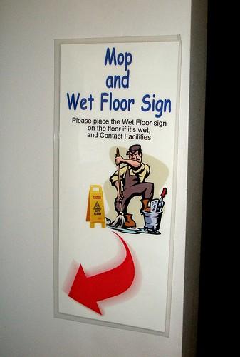 'mop and wet floor sign' sign
