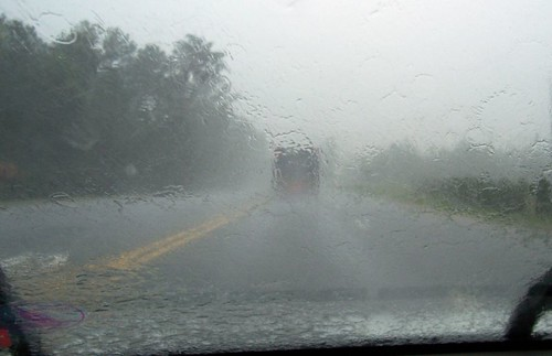 Following dump truck in rain