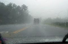 Following dump truck in rain