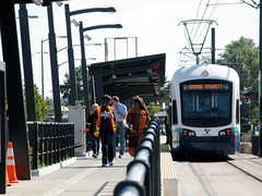 A Link train arrives at Othello Station in Rainier Valley. Photo by Oran Viriyincy.