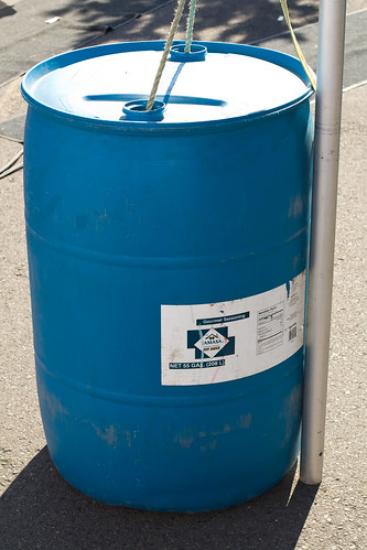 a blue 55-gallon chemical barrel