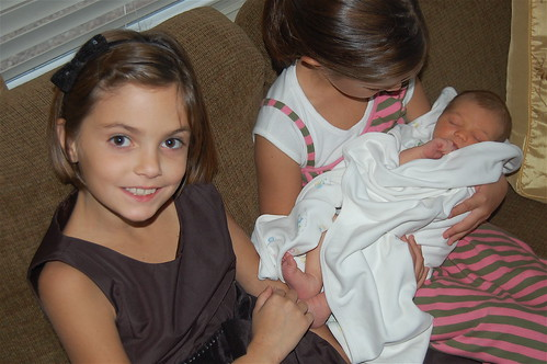 GIRLS HOLDING HIM