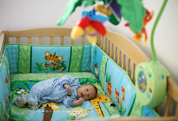 Enjoying the space in his crib