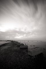 No Where (Khaled A.K) Tags: sea blackandwhite bw seascape pier rocks surrealism surreal slowshutter sa jeddah saudiarabia khaled bnw waterscape ksa saudia longecposure kashkari