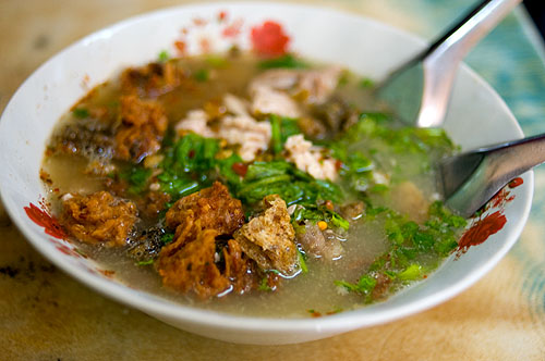 A bowl of tom yam samong muu, Chinese-style pig brain soup, Bangkok