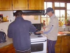 Graham & JD cooking breakfast
