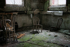 Quicksand (Desolate Places) Tags: abandoned hospital state chairs basement tunnels asylum sinking corrosive