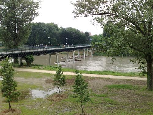 Debris forming a dam halfway across the river Po