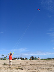 Kite flying (Arria Belli) Tags: blue boy sky orange kite beach play windy sunny nephew plage garon kourou cerfvolant frenchguiana