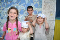Smiles in a Refugee Camp (hazy jenius) Tags: camp people smile kids children israel palestine westbank nablus refugee middleeast askar