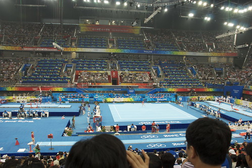 The stadium is crowded, noisy and everything is happening at once. Its amazing the gymnasts can concentrate.
