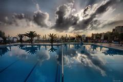 (Stevacek) Tags: morning sky pool clouds sunrise reflections d50 palms nikon kreta creta swimmingpool crete aphrodite hdr sigma1020mm stevacek aphroditebeachhotel