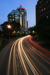 Bloor Street East and Mount Pleasant Road, Toronto (Tony Lea) Tags: life street city longexposure bridge light ted toronto ontario canada blur streets home race way evening moving twilight rat long exposure downtown glow mt looking slow traffic time oz wizard walk ttc mountpleasant headquarters down east mount explore rogers yonge jarvis curve streaks insurance bloor pleasant confederation stopped northbound nght southbound mtpleasant lightstreaks sherbourne lightstream explored i500 interestingness334 abigfave rubyphotographer qualitypixels dreamscapsoftoronto flickraward