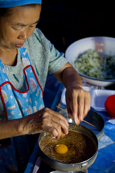 Making khao soi noi, a Shan dish, on the streets of Mae Sai, Chiang Rai, Thailand