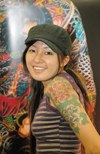 Asian girl with flower tattoo and koi