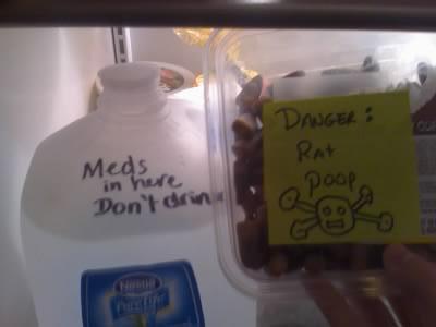 1. Meds in here Don't drink 2. Danger: Rat Poop