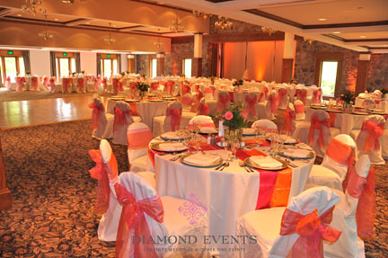 Table centerpieces at the German Club by Diamond Events in pink and orange