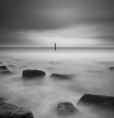The Lonely Pole (Corica) Tags: uk longexposure greatbritain sea england coast rocks britain yorkshire northsea whitby northyorkshire sandsend sigma1020mm corica canon400d dapagroupmeritaward pixelda