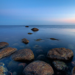 stone path to horizon (H o g n e) Tags: ocean longexposure blue sunset sea summer seascape beach water rock stone landscape evening coast carved dusk smooth shoreline bluesky explore shore silence stillwater minimalistic clearsky rockformations jren stonebeach carvedstone carvedrock smoothwater explored smoothsurface smoothstone bildekritikk smoothrock silkwater