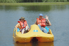 Brothers can work together 2 (Poopshe_Bear) Tags: boy summer vacation lake water hat smiling boat pond brothers paddle wave teen teenager float paddleboat pedal pedalboat flotation