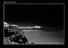 Dark Noon (Robert Varga Photographer) Tags: ocean sea outcrop nature water monochrome rock horizontal clouds landscape coast blackwhite quiet tide rocky peaceful coastal remote tropics extremeterrain blackwhitephotos aplusphoto auselite theunforgettablepictures