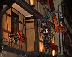 Eguisheim by night (Michele*mp slowly catching up) Tags: france sign night facade evening frankreich europe village alsace marx soir nuit pretzel halftimbered enseigne colombages bretzel hautrhin routedesvins lesplusbeauxvillagesdefrance eguisheim michelemp weekendmaisonscolombages