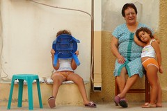 shy  girls (Rococo57) Tags: family blue orange girl wall children chair grandmother hide awareness dontlookatme rococo57