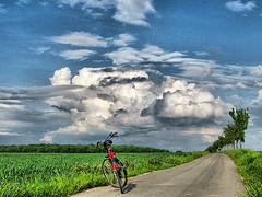 passeggiando in bicicletta..... (vamp9919) Tags: clouds countryside searchthebest bycicle digitalcameraclub golddragon mywinners platinumphoto diamondclassphotographer flickrdiamond ysplix platinumheartaward picturefantastic trashbit goldstaraward theloveshack thankspaolo loebiz