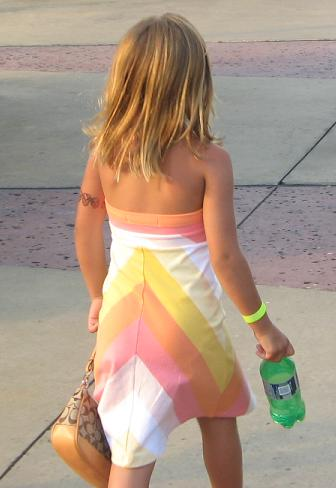 Like daughter, with arm tattoo