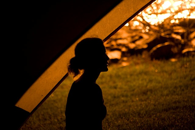 woman at campfire