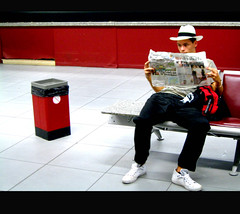 Las Vegas goes Europe (Paulchen...mostly off. :)) Tags: red news hat bench sitting lasvegas bin papers