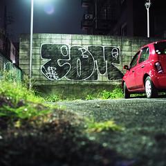 concrete block (F_blue) Tags: streetart tokyo kodak hasselblad roppongi graffitiart  500cm portra160nc  planart c8028 fblue2008