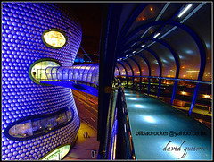 Birmingham Night : The Selfridges at the Bullring (david gutierrez [ www.davidgutierrez.co.uk ]) Tags: city bridge blue windows sky urban building colors architecture modern night shopping dark spectacular geotagged photography design store arquitectura birmingham cityscape darkness searchthebest dusk centre cities bridges restaurants center bull structure best architectural ring nighttime selfridges finepix shops architektur nights fujifilm sensational metropolis topf100 department soe impressive bullring nightfall municipality edifice the skywalk boutiques innovative supershot 100faves fineartphotos s6500fd mywinners anawesomeshot impressedbeauty superaplus aplusphoto fujifilmfinepixs6500fd theunforgettablepictures theperfectphotographer goldstaraward tup2 multimegashot rubyphotographer dragondaggerawards