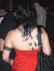 Flock of Tattoos (alleenski) Tags: red birds wisconsin back women feathers tattoos madison nightlife bags crows 2008 highnoonsaloon brunettes nape halters forwardmusicfest